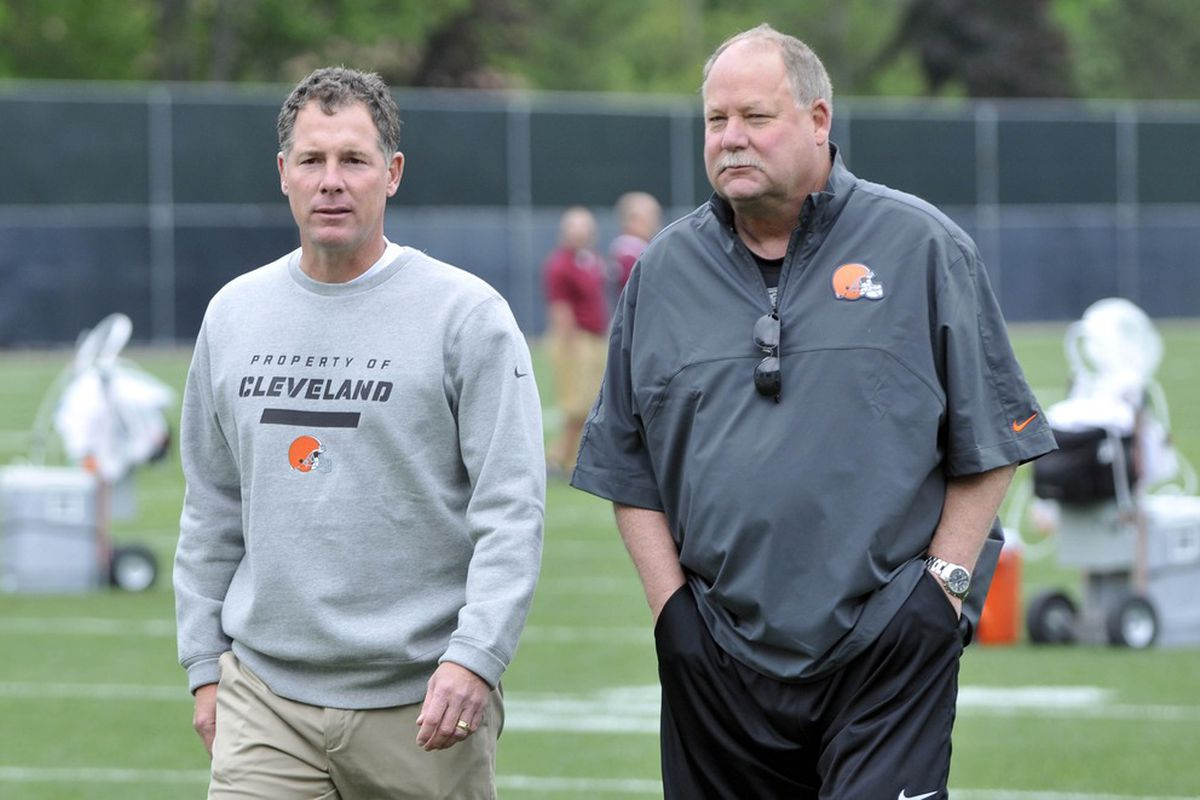 Jun 5, 2012; Berea, OH, USA; Cleveland Browns head coach Pat Shurmur (left) walks with team president Mike Holmgren during minicamp at the Cleveland Browns training facility. Mandatory Credit: David Richard-US PRESSWIRE