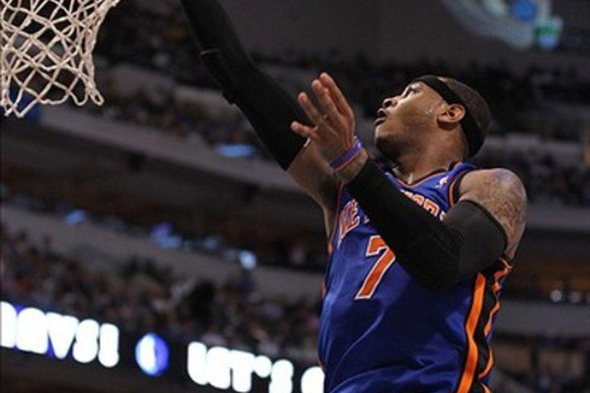 Mar 6, 2012; Dallas, TX, USA; New York Knicks forward Carmelo Anthony (7) shoots against the Dallas Mavericks at American Airlines Center.  Mandatory Credit: Matthew Emmons-US PRESSWIRE