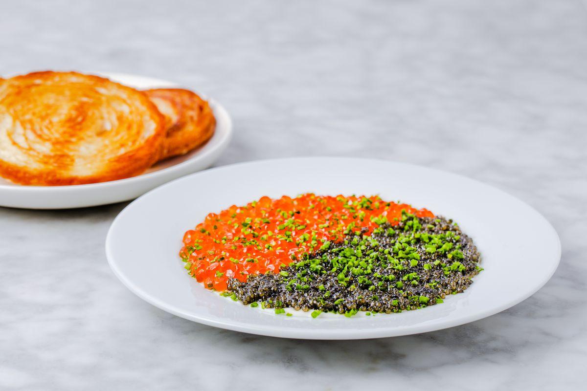 Sterling caviar with bottarga, egg yolk jam, and burnt chive creme from Fellow Traveler.
