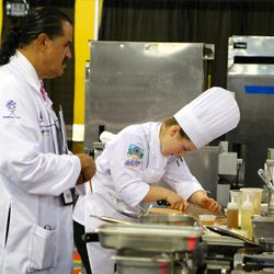 A judge watches Utah Valley University culinary student Madeline Black during the American Culinary Federation Cook. Craft. Create. national convention on July 8-13 in Orlando, Florida. Black was named the National Student Chef of the Year after making a winning dish including truffle-scented duck roulade finished in duck fat, with Utah honey lacquered duck thigh-riblet.