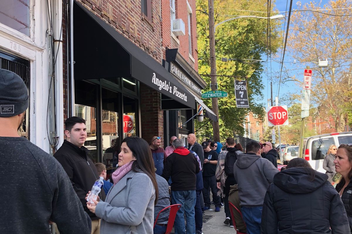 line of people outside pizza shop