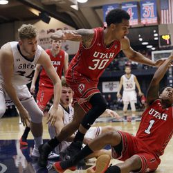 Utah guard Justin Bibbins (1) grabs a loose ball next to teammate Gabe Bealer (30) and Saint Mary's center Jock Landale, left, during the second half of an NCAA college basketball game in the quarterfinals of the NIT, Wednesday, March 21, 2018, in Moraga, Calif. (AP Photo/Marcio Jose Sanchez)