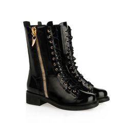 "<b>Giuseppe Zanotti</b> combat boots in black, <a href=""http://www.giuseppezanottidesign.com/us/women/boot_cod44546167cr.html?collection_id=23461"">$1450</a>"