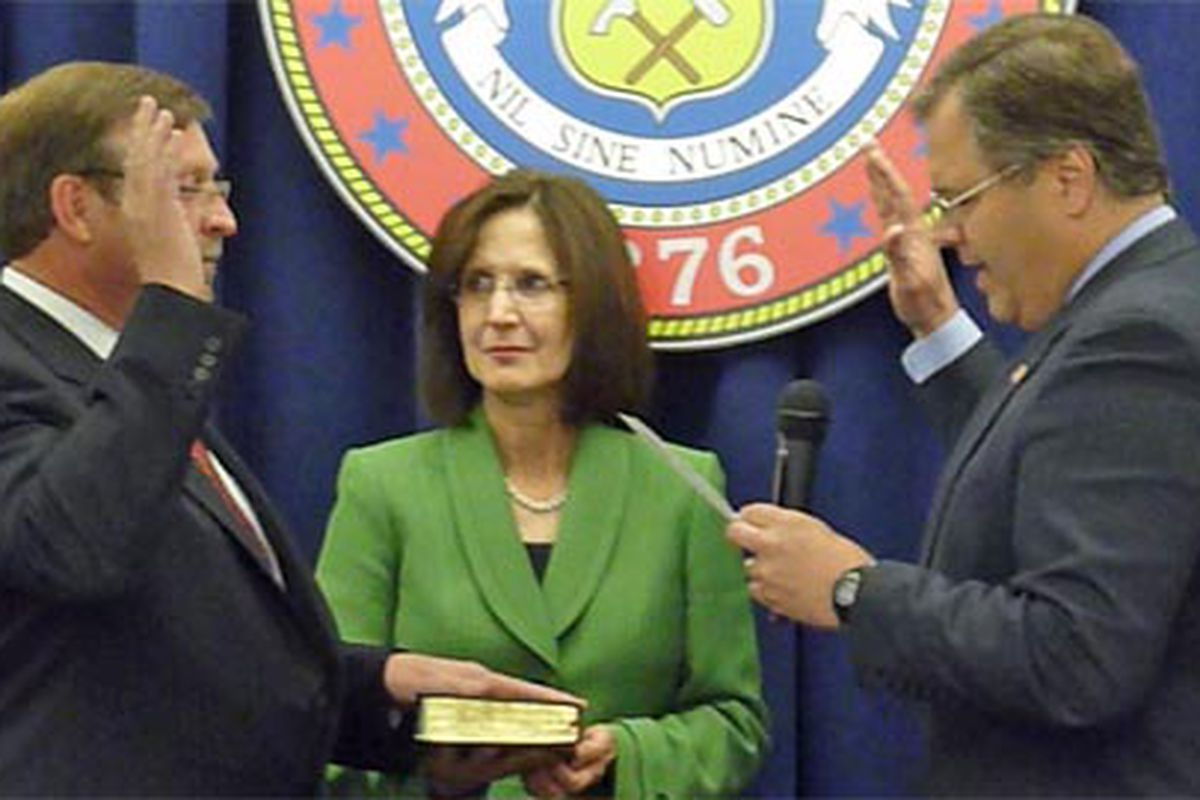 Education Commissioner Robert Hammond (left) took the oath of office May 11, 2011, from SBE Chair Bob Schaffer. Hammond's wife, Ranelle Lang, holds the Bible. She's former superintendent in Greeley.