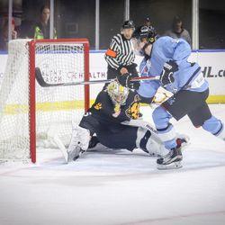 Boston Pride goaltender Brittany Ott makes a save on Buffalo Beauts forward Rebecca Vint.