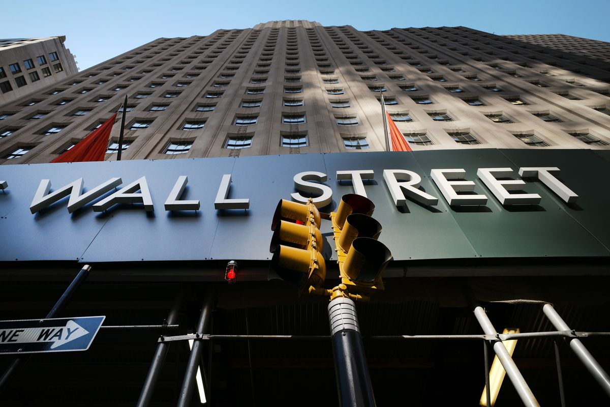 In this May 19, 2021 file photo, a sign for a Wall Street building is shown, Wednesday, May 19, 2021, in New York. Stocks are off to a sluggish start on Wall Street Monday, June 14 easing the S&P 500 index just below its latest record high. The benchmark index is also coming off its third weekly gain in a row.