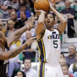 Utah Jazz guard Devin Harris (5) puts up a shot over Orlando's #14 Jameer Nelson as the Utah Jazz and the Orlando Magic play Saturday, April 21, 2012 in Energy Solutions arena.