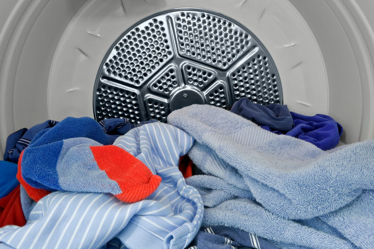 Inside view of dryer with clothes inside.
