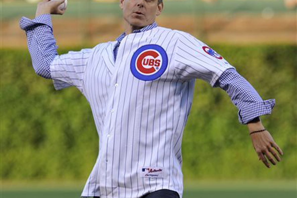 FILE - In this Aug. 13, 2013, file photo, wldESPN radio host Colin Cowherd tosses out a ceremonial pitch before a baseball game between the Cincinnati Reds and Chicago Cubs in Chicago. Major League Baseball says ESPN Radio host Colin Cowherd owes Dominica
