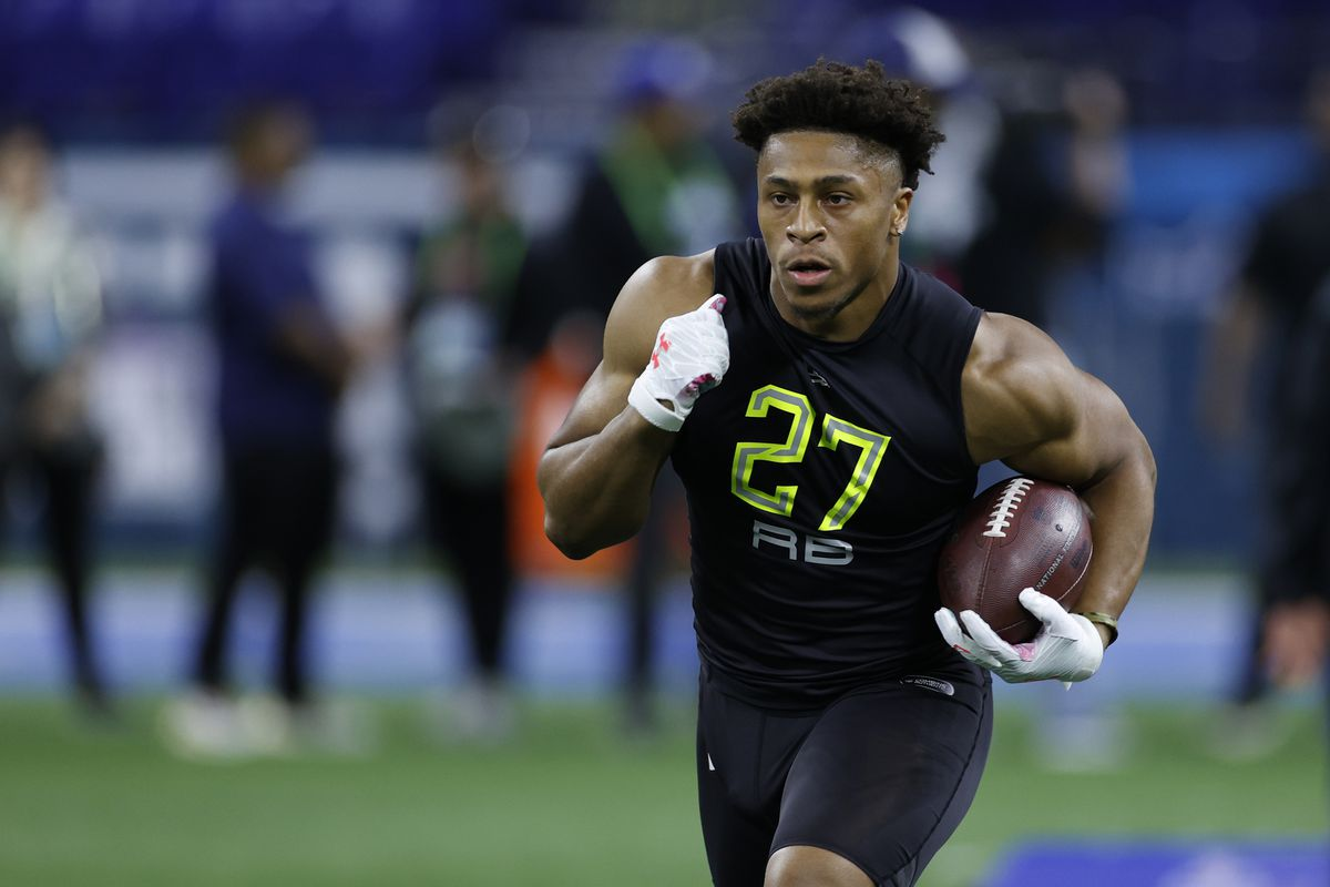 Running back Jonathan Taylor of Wisconsin runs a drill during the NFL Combine at Lucas Oil Stadium on February 28, 2020 in Indianapolis, Indiana.