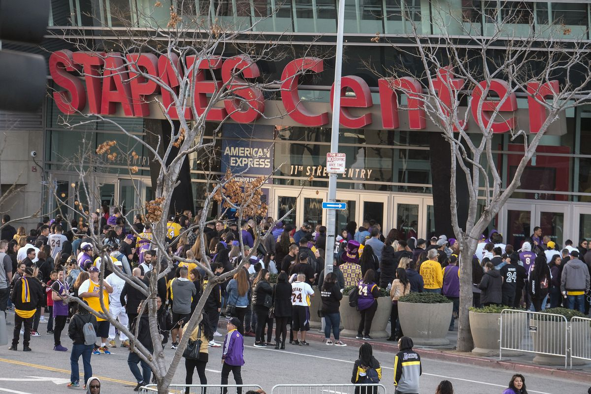 Fans line up to get into the Staples Center to attend a public memorial for former Los Angeles Lakers star Kobe Bryant and his daughter, Gianna, in Los Angeles, Monday, Feb. 24, 2020. (AP Photo/Ringo H.W. Chiu)