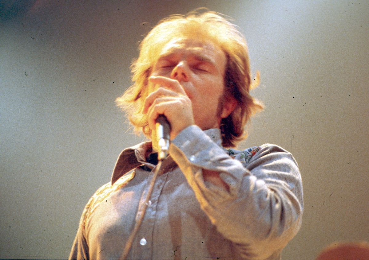 Close-up of Van Morrison singing into a mic