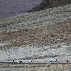 The first wave of runners leaves Badwater Basin during the AdventurCORPS Badwater 135