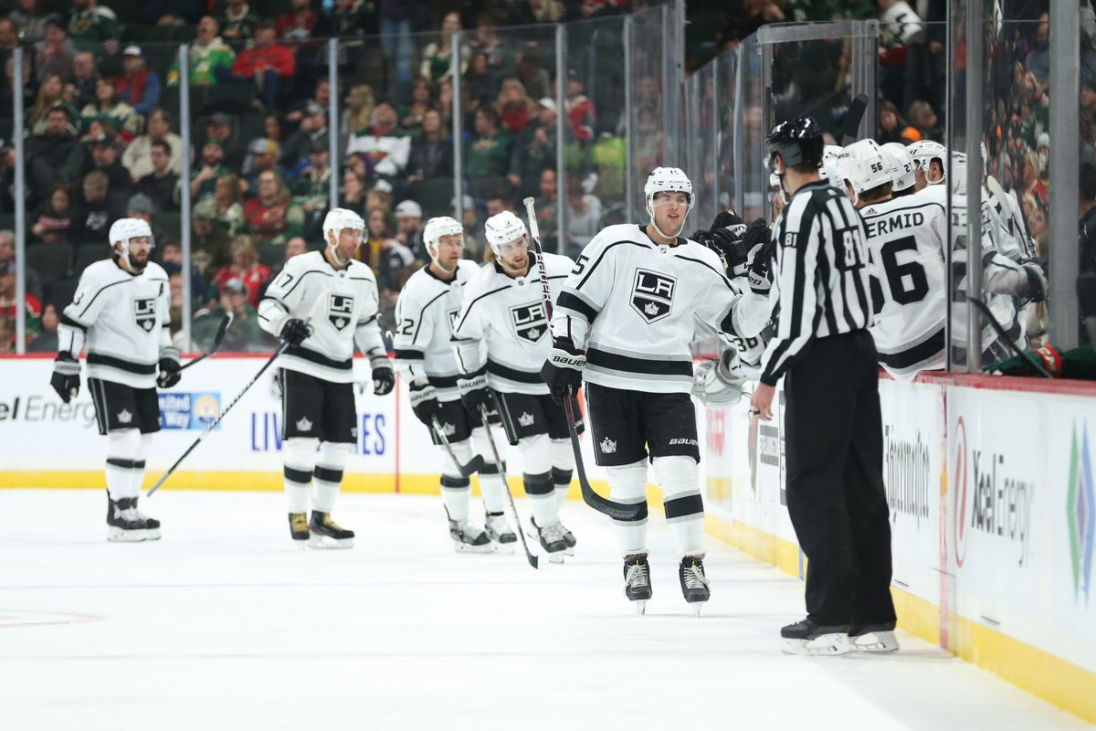 Los Angeles Kings defenseman Ben Hutton (15) celebrates with teammates after scoring a goal against the Minnesota Wild during the second period at Xcel Energy Center.
