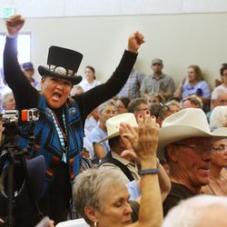 Nicole Walker and others cheer after comments during a meeting in Bluff with Interior Secretary Sally Jewell, as she visits Canyon Counrty in southern Utah on Saturday, July 16, 2016.