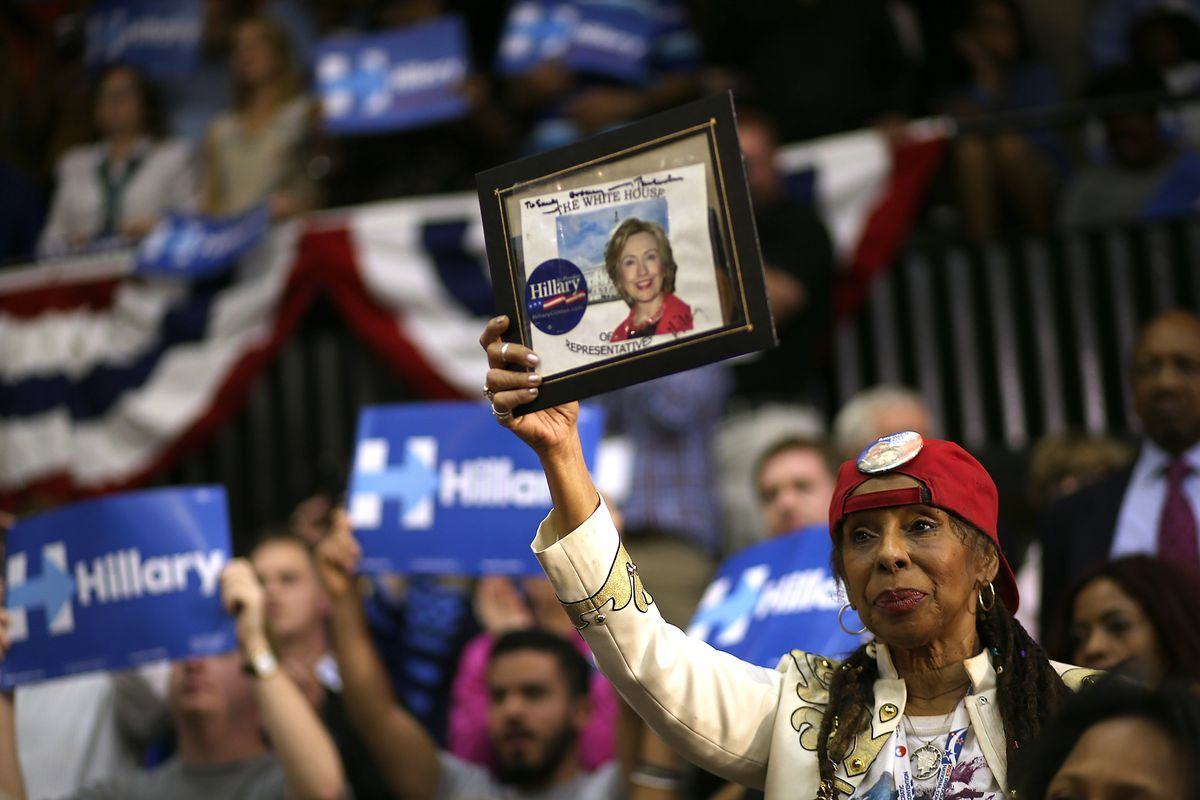 Supporters look on as democratic presidential candidate former Secretary of State Hillary Clinton speaks during a Get Out the Vote event at Grady Cole Center on March 14, 2016, in Charlotte, North Carolina.