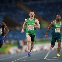 Irish athlete Jason Smith, center, runs to win the second heat of the men's 100-meter T13 athletic event of the Rio Paralympic games in Rio de Janeiro, Brazil, Thursday, Sept. 8, 2016.