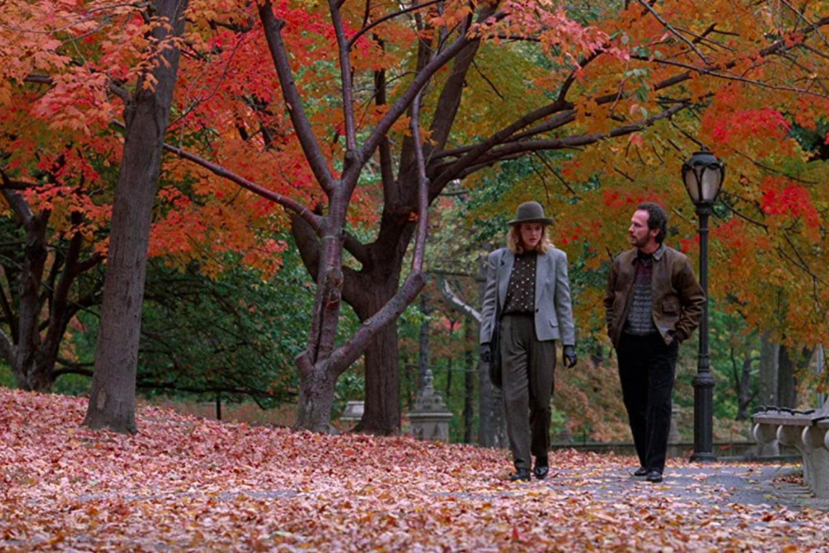 """Meg Ryan and Billy Crystal walk through failed leaves on a fall tree-lined lane in the movie """"When Harry Met Sally."""""""