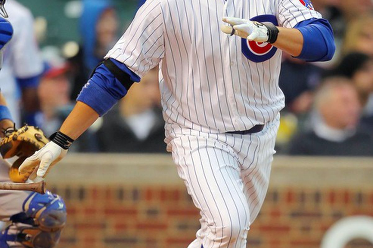 May 6, 2012; Chicago, IL, USA; Chicago Cubs first baseman Bryan LaHair (6) hits a double during the fourth inning against the Los Angeles Dodgers at Wrigley Field. Mandatory Credit: Dennis Wierzbicki-US PRESSWIRE