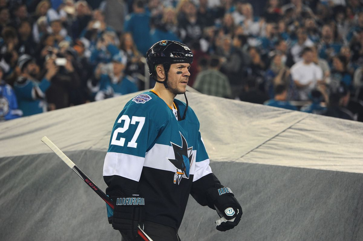 Scott Hannan #27 of the San Jose Sharks walks to the ice surface for the 2015 Coors Light NHL Stadium Series game between the Los Angeles Kings and the San Jose Sharks at Levi's Stadium on February 21, 2015 in Santa Clara, California. The Kings defeated the Sharks 2-1.