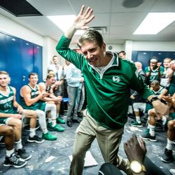 UVU President Matt Holland celebrates with the Wolverines basketball team after they beat BYU in November 2016.