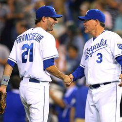 Manager Ned Yost of the Kansas City Royals congratulates right fielder Jeff Francoeur #21 after a game against the Cleveland Indians at Kauffman Stadium on September 3, 2011 in Kansas City, Missouri. The Kansas City Royals defeated the Cleveland Indians 5-1.