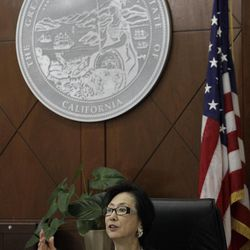 Judge Lillian Sing gestures to a defendant on the bench of the Community Court Tuesday, Sept. 18, 2012, in San Francisco. While it's been difficult for researchers to determine cost savings by the courts, new studies suggest the courts are helping stem crime. An evaluation of Washington, D.C.'s community court by the Westat research firm found this summer that defendants who successfully completed diversion programs from 2007 to 2009 were half as likely to reoffend as similar defendants in a traditional court.