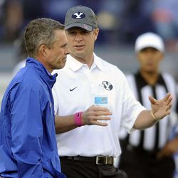Boise State Broncos head coach Chris Petersen, left, and Brigham Young Cougars head coach Bronco Mendenhall talk prior to the start of their game at Lavell Edwards Stadium on Friday, October 25, 2013.