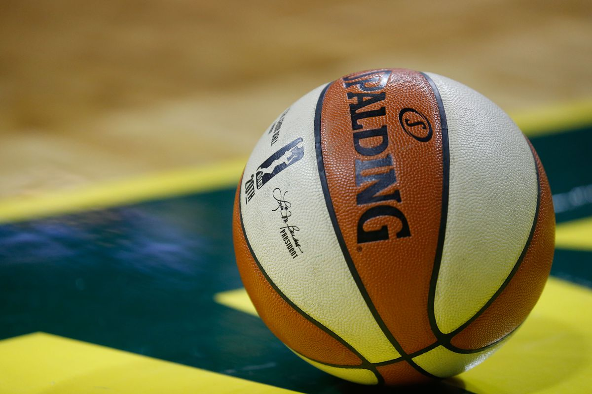 The WNBA logo on a ball during the fourth quarter of game one of the WNBA finals between the Seattle Storm and the Washington Mystics at KeyArena.