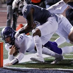 Weber State Wildcats quarterback Stefan Cantwell is pushed out of bounds just in front of the goal by Southern Utah Thunderbirds cornerback Jalen Russell during NCAA football in Cedar City on Saturday, Dec. 2, 2017.