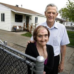 Mandi Shaw and Ron Baker stand outside Shaw's Kearns home on Wednesday, April 18, 2012.