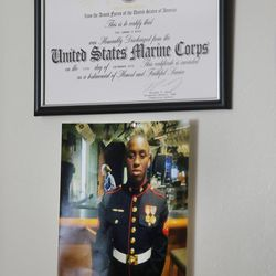 A military certificate belonging to Lamar Ross hangs on a wall in his Ogden home on Monday, Oct. 9, 2017. Ross believes his uncle, Patrick Harmon, who shot and killed by a Salt Lake City police officer in August, was murdered.