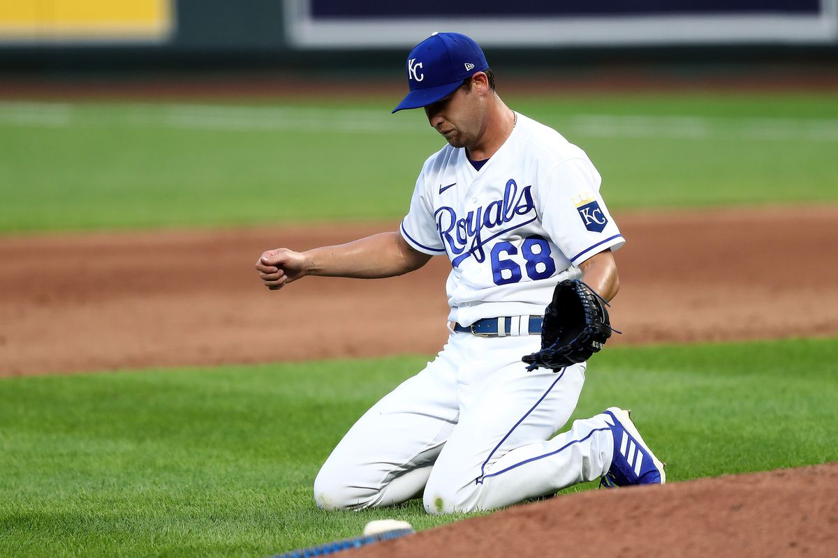 Jake Newberry #68 of the Kansas City Royals reacts after an error during the 5th inning of the game against the Chicago White Sox at Kauffman Stadium on August 01, 2020 in Kansas City, Missouri.