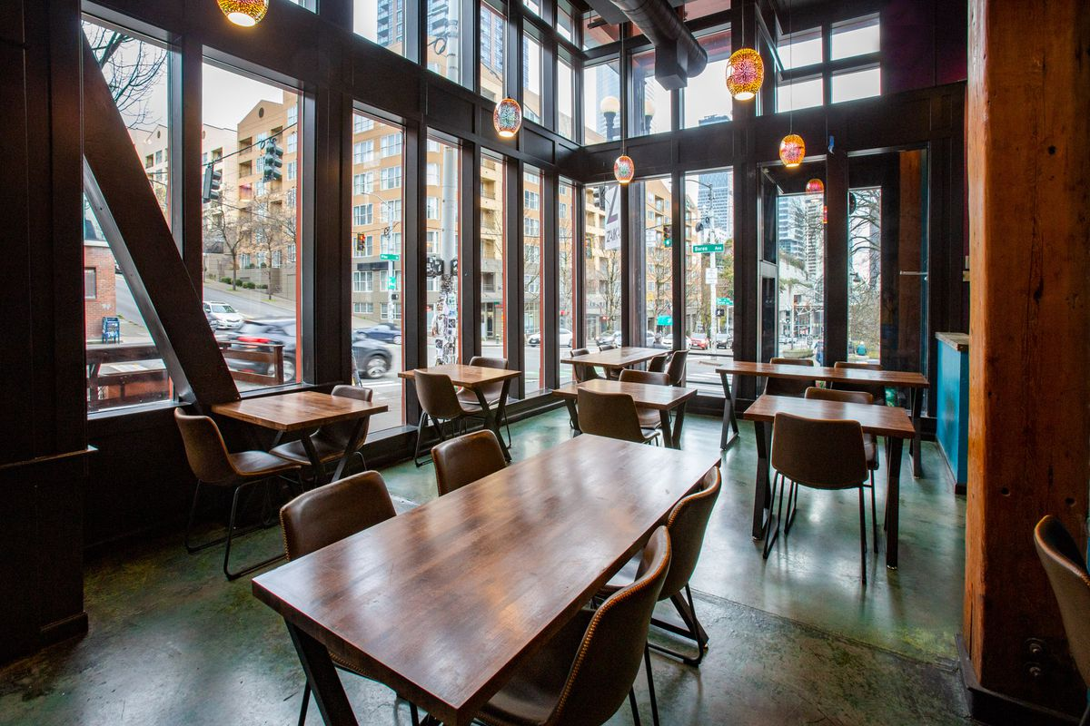 Zaika's dining room, with large floor-to-ceiling windows looking out onto the street.