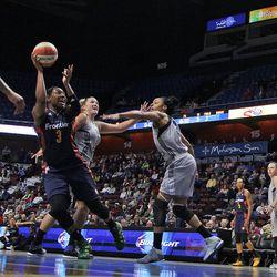 Connecticut Sun's Kelsey Bone (3) is fouled by San Antonio Stars' Jane Appel-Marinelli (32).