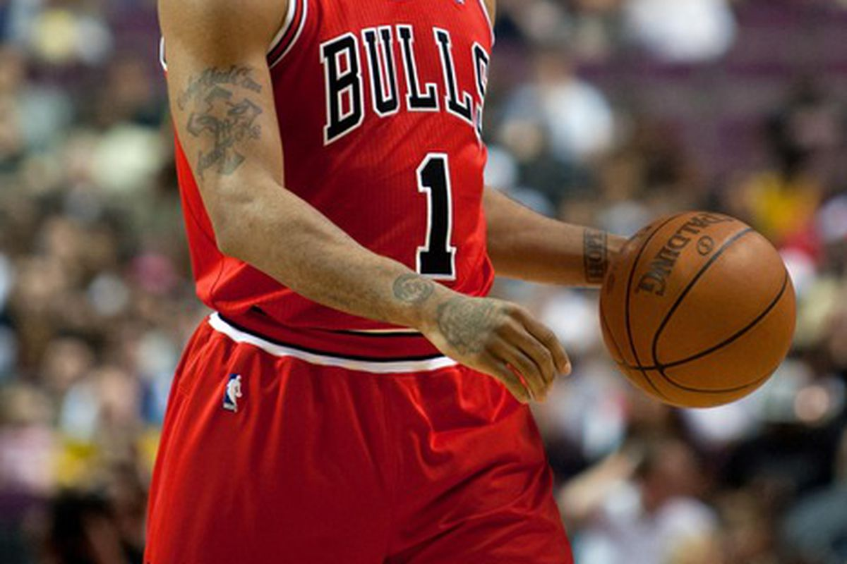 April 15, 2012; Auburn Hills, MI, USA; Chicago Bulls point guard Derrick Rose (1) brings the ball up court during the first quarter against the Detroit Pistons at The Palace. Mandatory Credit: Tim Fuller-US PRESSWIRE