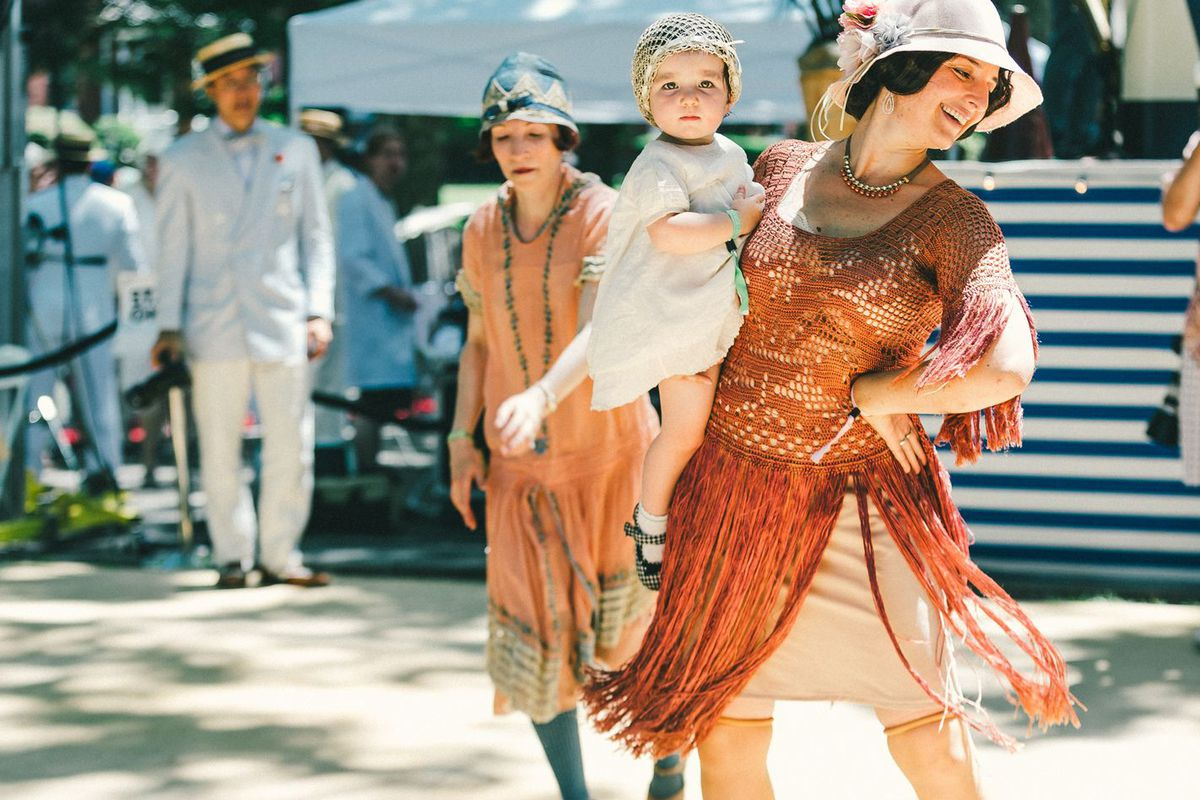 """A mom and baby at the <a href=""""http://ny.racked.com/2015/6/16/8786627/jazz-age-lawn-party-2015-photos#4769478"""">Jazz Age Lawn Party</a> in 2015"""