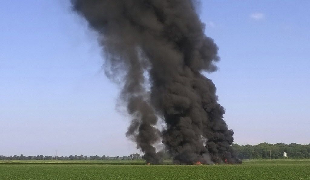 In this photo provided by Jimmy Taylor, smoke and flames rise into the air after a military transport airplane crashed in a field near Itta Bena, Mississippi, on the western edge of Leflore County, on Monday. | Jimmy Taylor via AP
