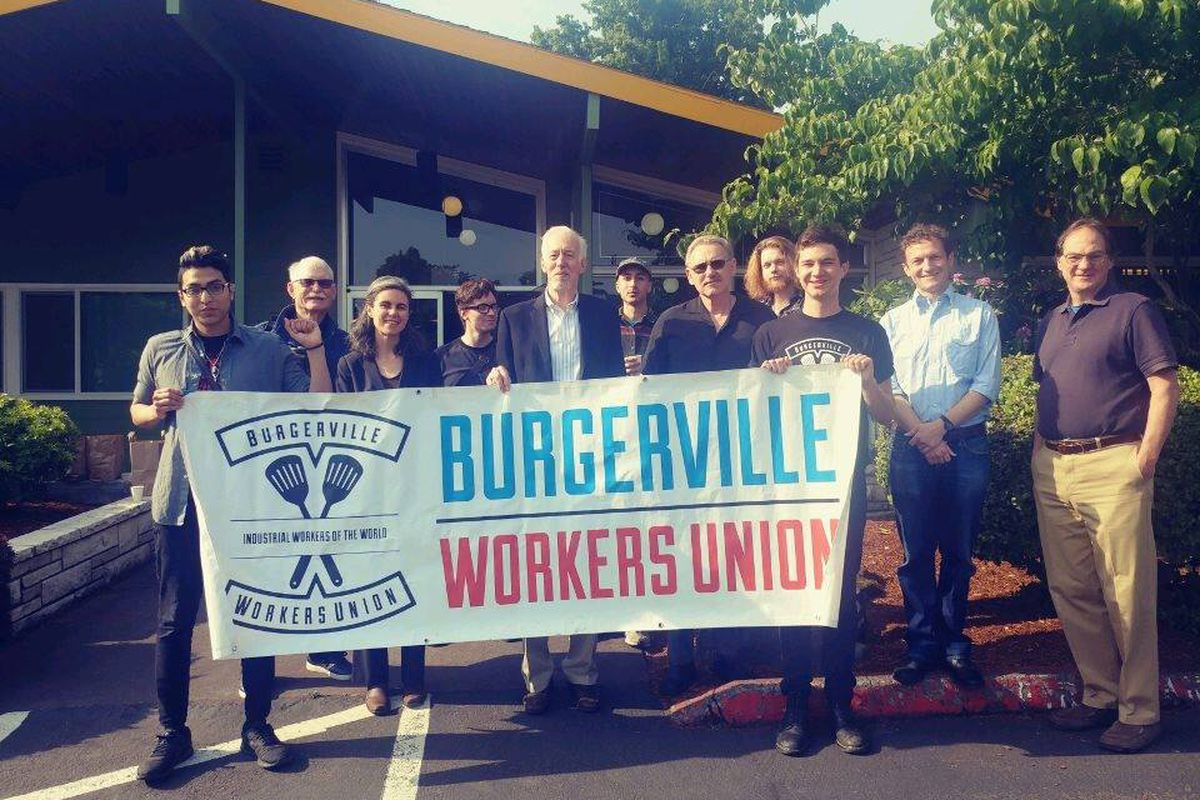 Several people standing with a Burgerville Workers Union sign.