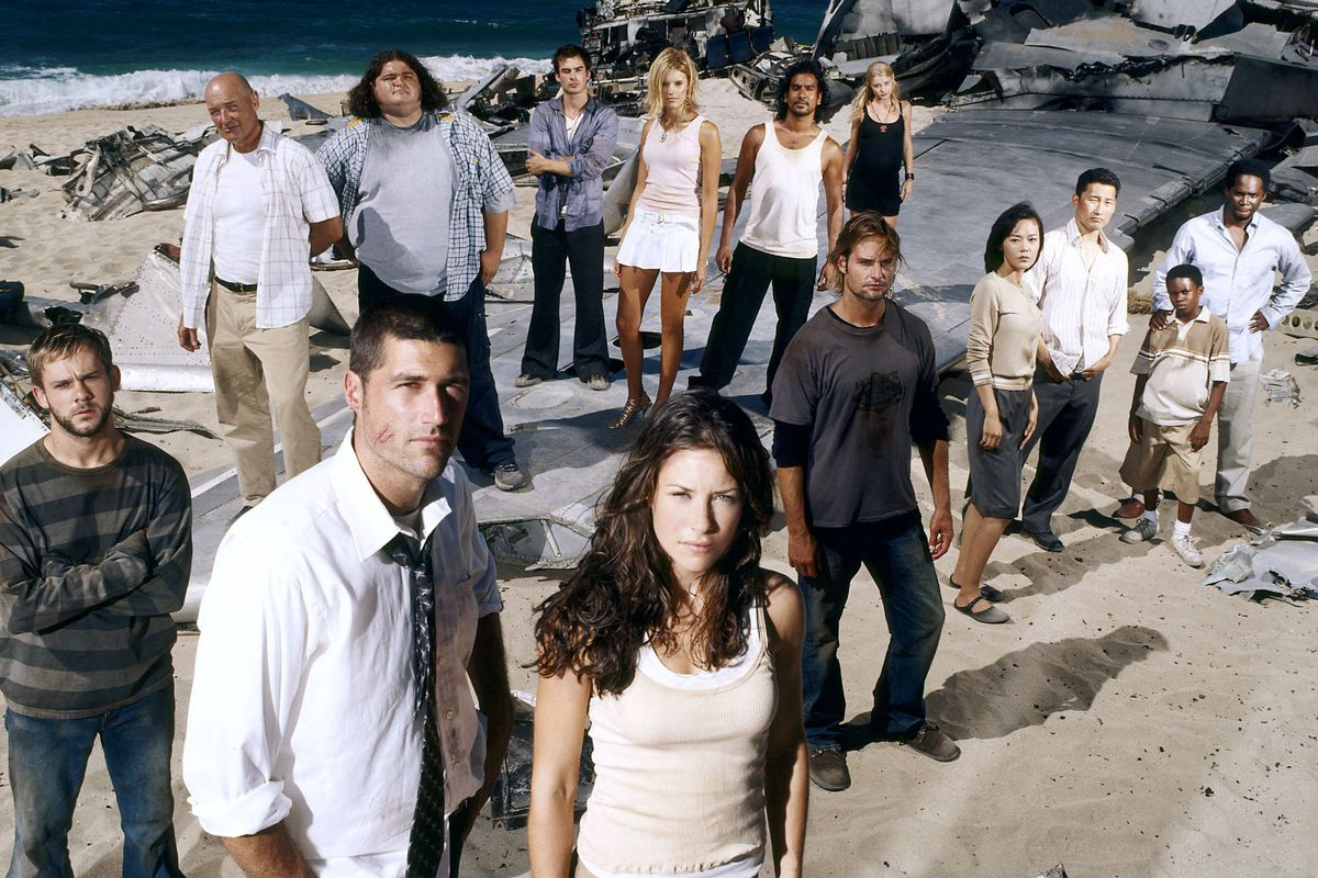 """The cast of """"Lost"""" hangs out on the beach where they were stranded in a plane crash."""