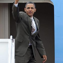 President Barack Obama waves as he boards Air Force One at Andrews Air Force Base, Md., Saturday, Sept. 1, 2012.