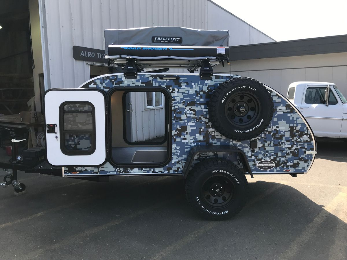 Teardrop Camper Trailer Uses A Rooftop Tent To Sleep A