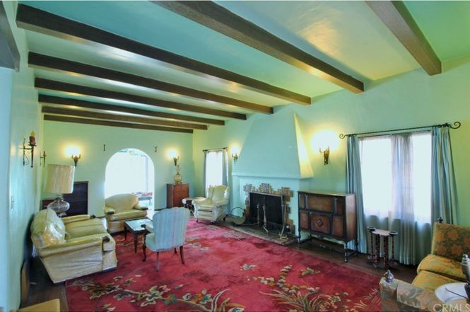 Living room with blue paint and beamed ceiling