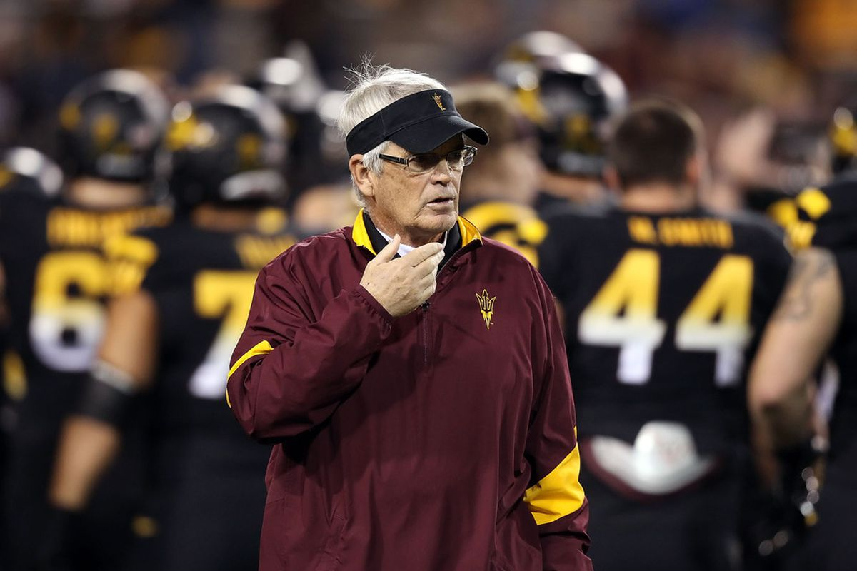 Head coach Dennis Erickson of the Arizona State Sun Devils watches warm ups before the college football game against the Arizona Wildcats at Sun Devil Stadium on November 19, 2011 in Tempe, Arizona.  (Photo by Christian Petersen/Getty Images)