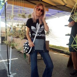 Stylist Brittany Hart mixed high-end hot pink Dior sunnies and a Missoni bag with Birks, overalls, and an Adidas tee-shirt.