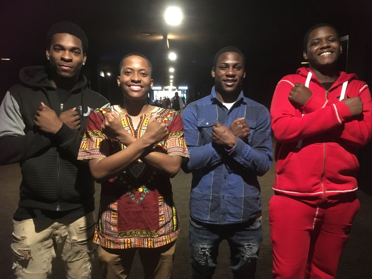 Surrell Austin, 18, Marlon Haywood, project manager for community engagement at Rush Medical Center, Jahleel Martinez, 17, and Kameron Chard, 17, were among a group attending a screening of the Black Panther movie for Chicago Public Schools students Monda