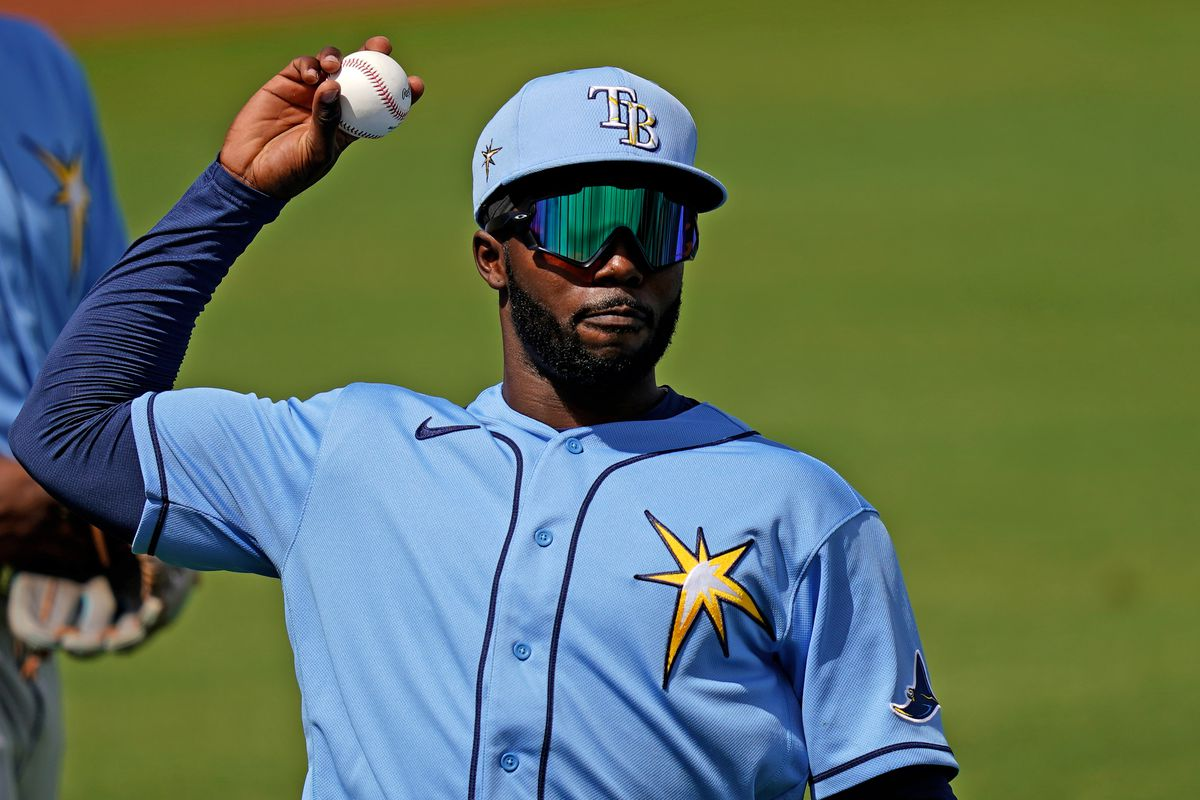 Tampa Bay Rays left fielder Randy Arozarena (56) warms up prior to the spring training game against the Boston Red Sox at JetBlue Park at Fenway South.