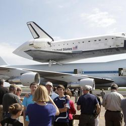 A large crowd takes photographs of the Space Shuttle Endeavour sitting atop NASA's 747 Shuttle Carrier Aircraft at Ellington Field in Houston on Wednesday, Sept. 19, 2012. Endeavour will spend the night in Houston before continuing its journey from the Kennedy Space Center in Florida to the California Science Center in Los Angeles where it will be on permanent display.