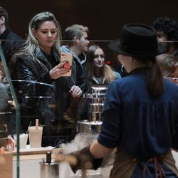 Customers lined up for coffee drinks and pastries Friday at Starbucks Reserve Roastery.