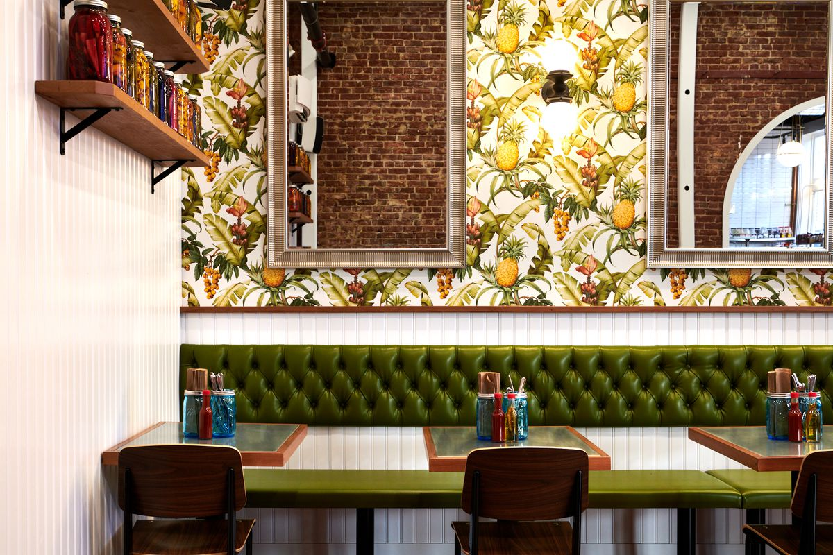 A picture of the mounted pickles on the wall of Bae's Chicken, which range from beet pickles to the classic cucumber